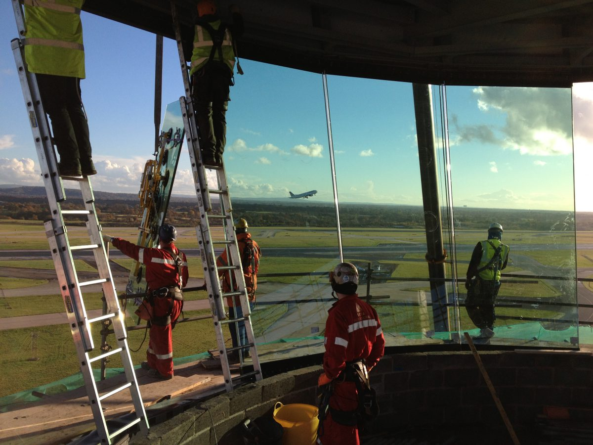 The Tex team install glass in the air traffic control room at Manchester