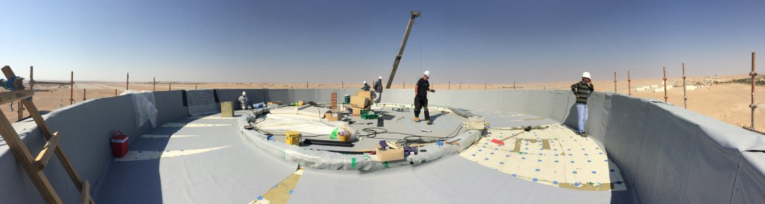 Tex ATC installing the roof membrane on an air traffic control tower