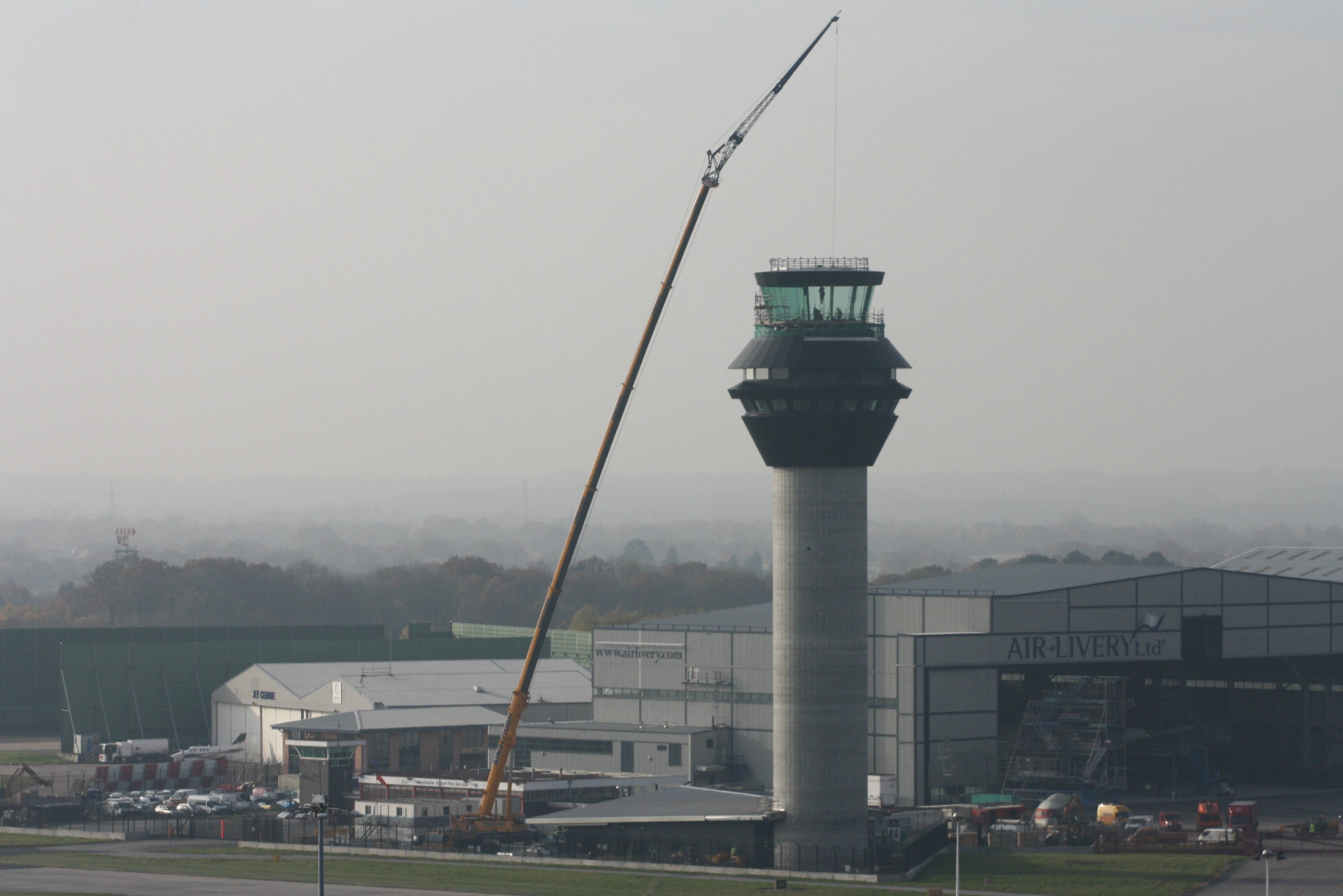 Tex ATC cranes glass into position on the Manchester air traffic control tower, UK